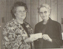 Foundation Gives Donation  Betty Mapes (left) Chairman of the Nance County Foundation, presents a $1,000 donation to Terri Bowman of the Fullerton Tree Board. The Tree Board has applied for a grant and if awarded will proceed to Phase II of their project which includes the removal of five trees and planting of an additional 22 trees on the outside of the city park.